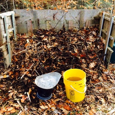 Outdoor Compost Pile With Bucket of Ash and Water